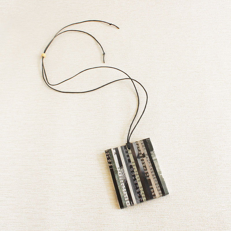 black and white newspaper necklace