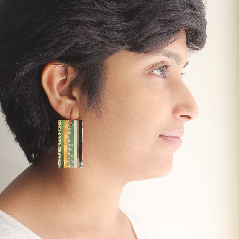 green jewelry made from recycled newspaper