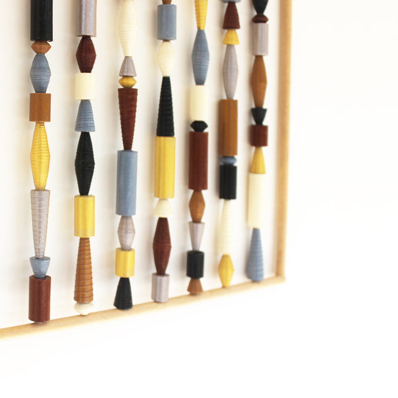 organic wall hanging from paper beads
